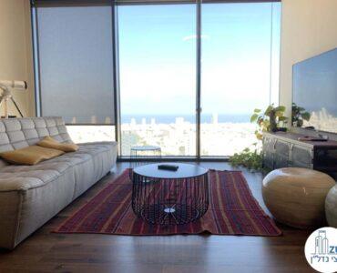 פינת ישיבה של משרד להשכרה במגדל מידטאון תל אביב