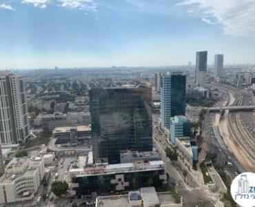 נוף למגדל סוזוקי מחלון של משרד להשכרה במגדלי אלון תל אביב