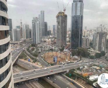 נוף מחלון במשרד של לקוחות מרוצים מעסקת מכירה במגדל רסיטל תל אביב